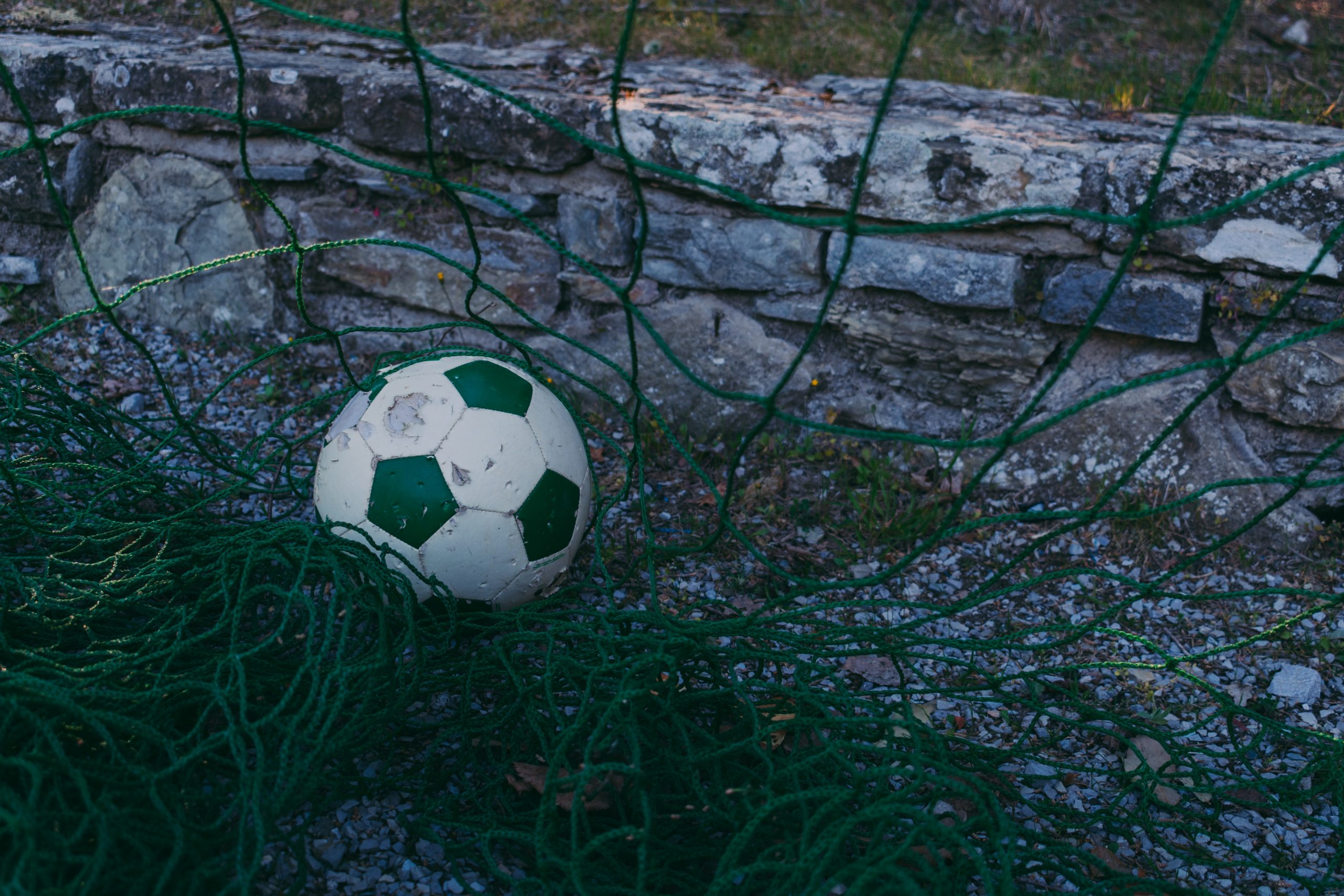 white and green soccer ball